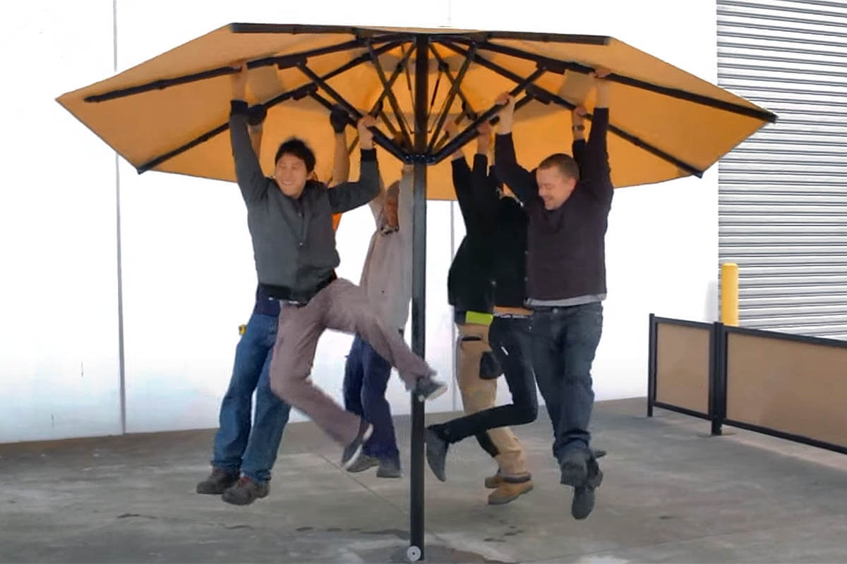 People Hanging From Umbrella